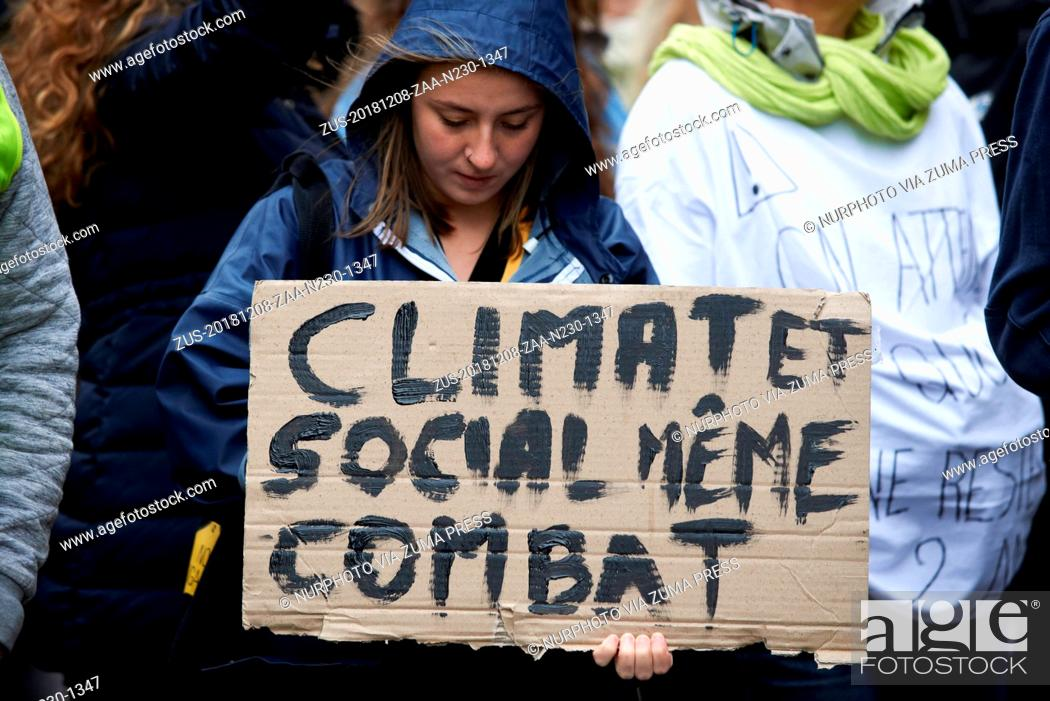 Stock Photo: December 8, 2018 - Toulouse, France - A young woman holds a placard reading Climate and Socila, same fight'. A March for the Climate took place in Toulouse with.