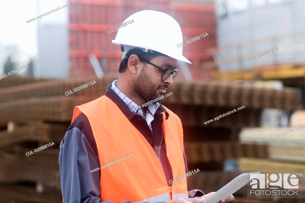Stock Photo: Civil engineer working at site.