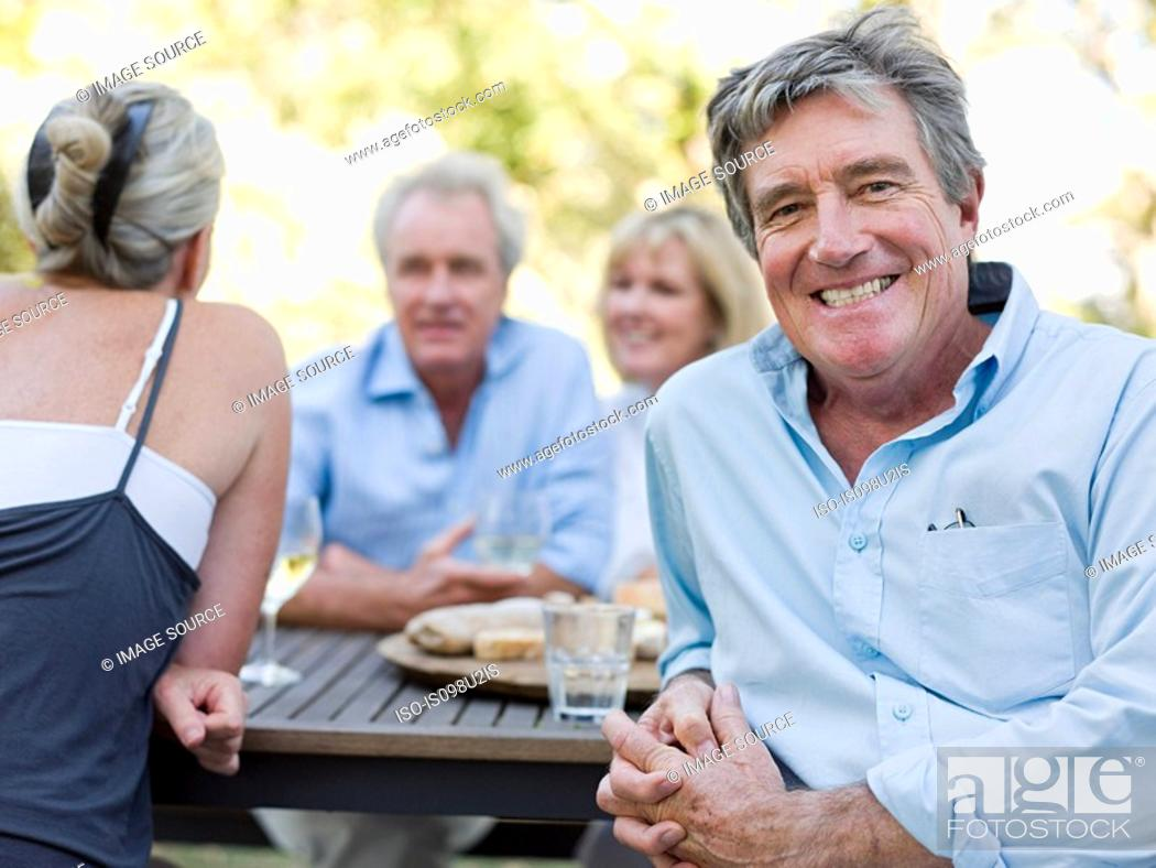 Stock Photo: Man at meal outdoors.
