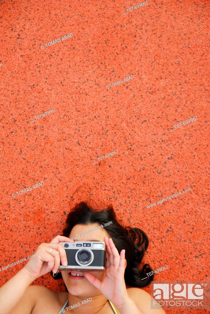 Stock Photo: Latino Woman holding a camera.