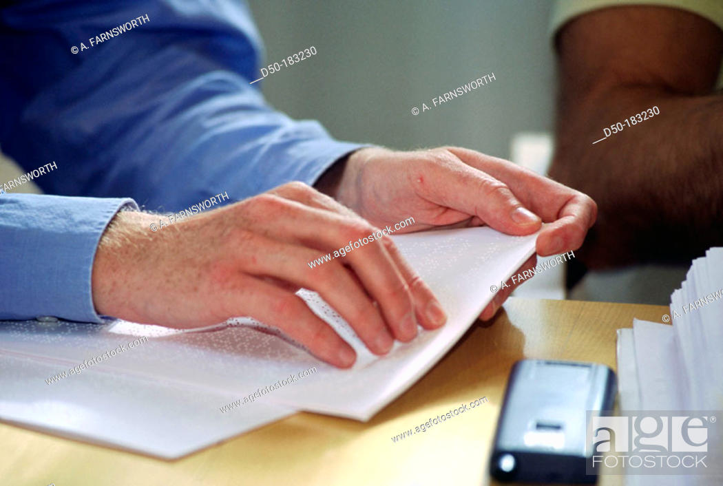 Stock Photo: Blind man reads braille.