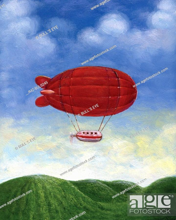 Stock Photo: A red blimp floating over green hills.