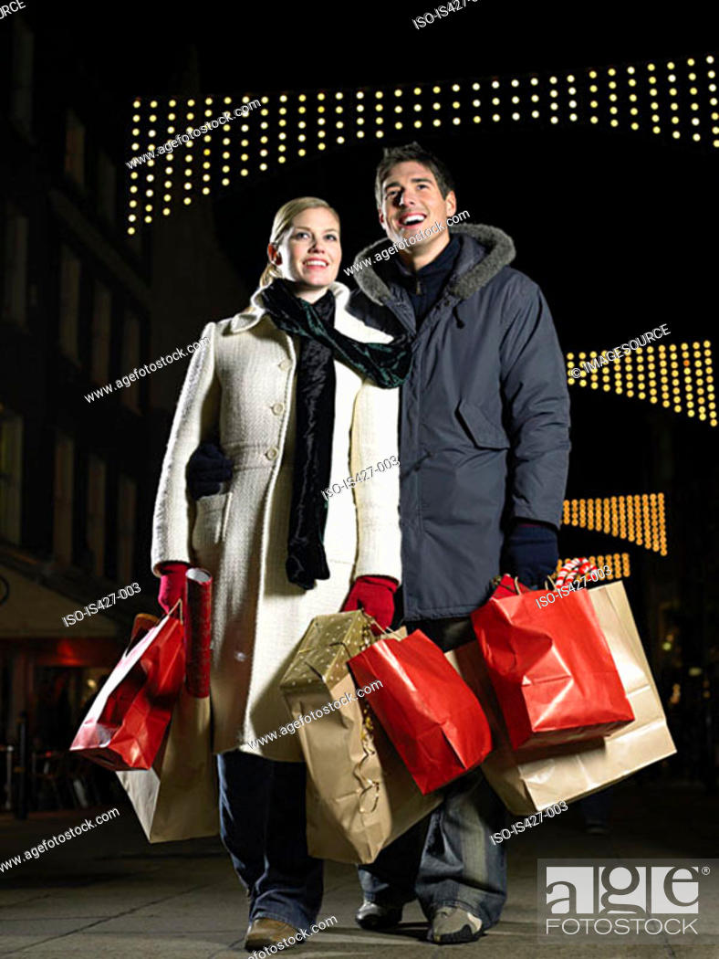 Stock Photo: Mid adult couple christmas shopping.