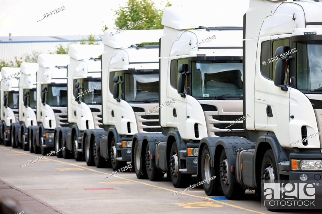 Stock Photo: Freight transportation trucks parked in a row.