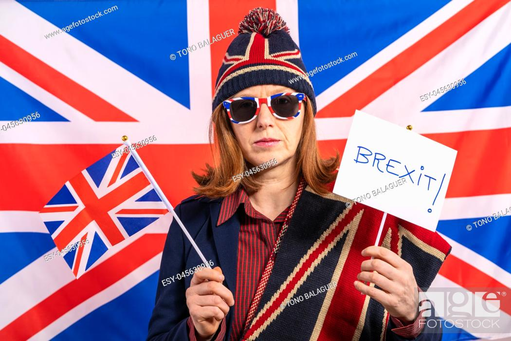 Stock Photo: British redhead woman with UK flag and Brexit banner.