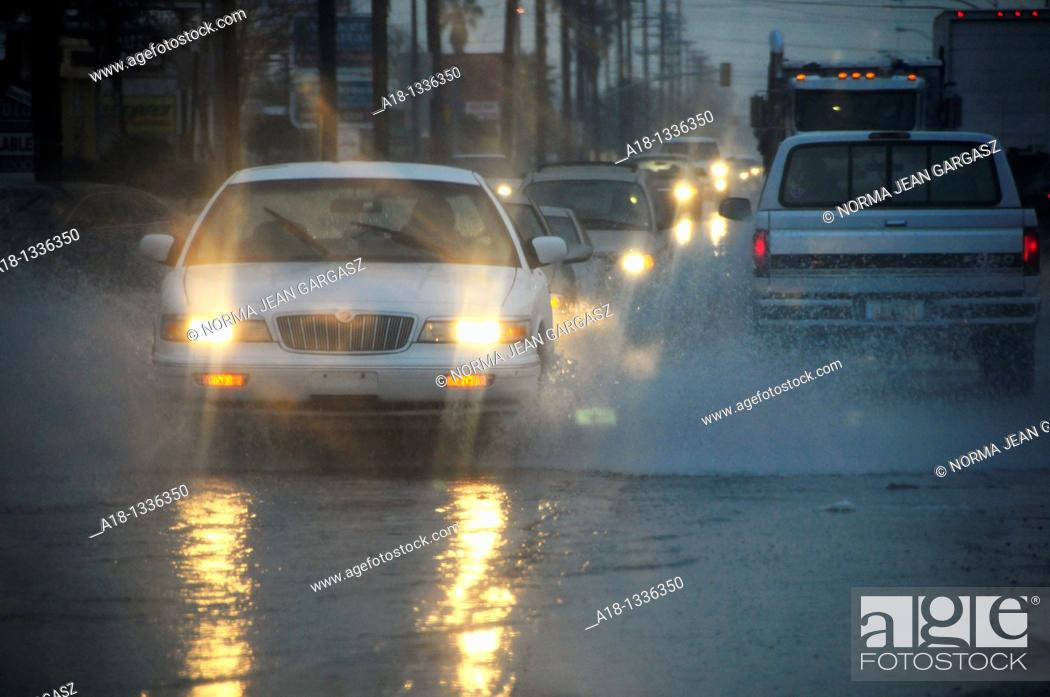 Stock Photo: A rain storm that brought snow to the higher elevations floods streets and snarls traffic in Tucson, Arizona, USA.