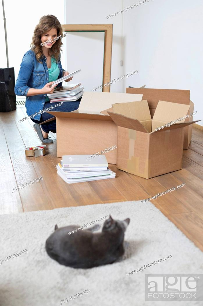 Stock Photo: Woman looking at her cat and smiling.
