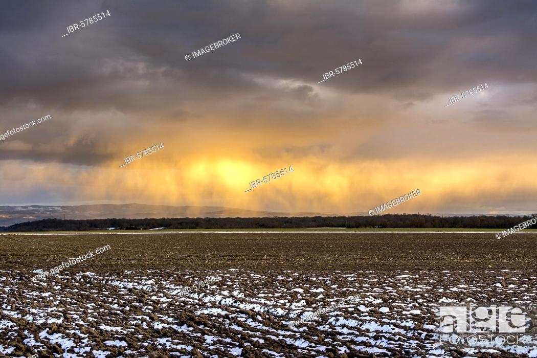 Stock Photo: Rain cloud over winter landscape, Puy de Dome department, Auvergne Rhone Alpes, France, Europe.