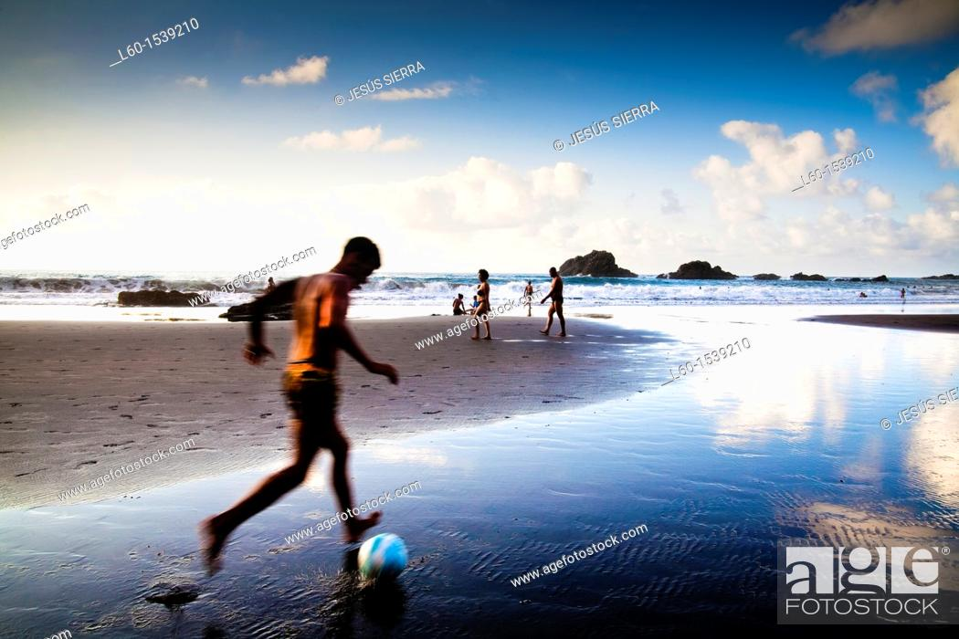 Stock Photo: boy playing soccer in the beach, San Roque beach, Tenerife, Canary Islands, Spain.