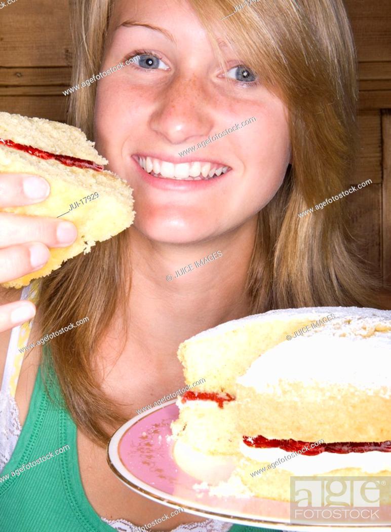 Stock Photo: Close up of girl holding victorian sponge cake.