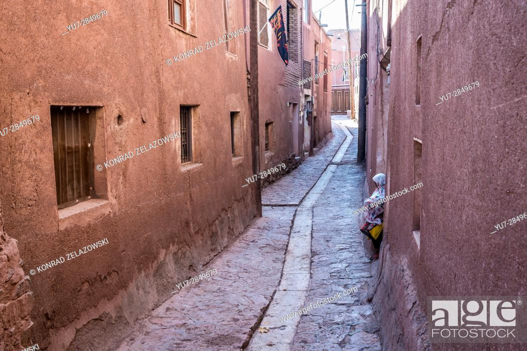 Stock Photo: Narrow street with drainage channal in famous red village Abyaneh in Natanz County, Isfahan Province, Iran.