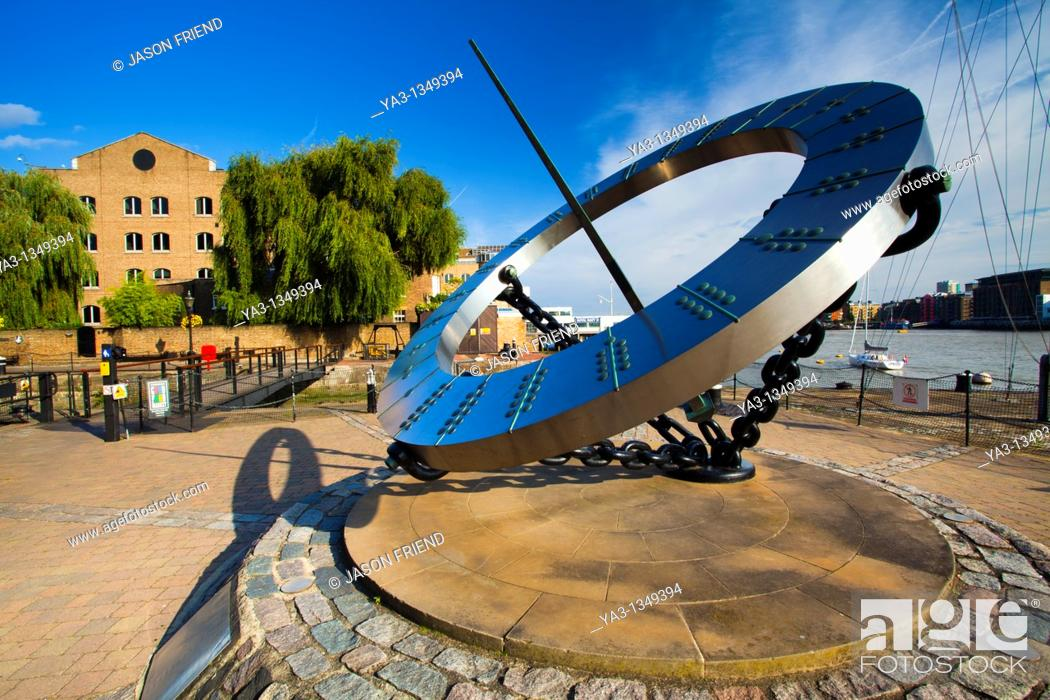 Stock Photo: England, Greater London, London Borough of Tower Hamlets  Sun dial near the entrance to the St Katharine Docks, on the north bank of the River Thames near the.
