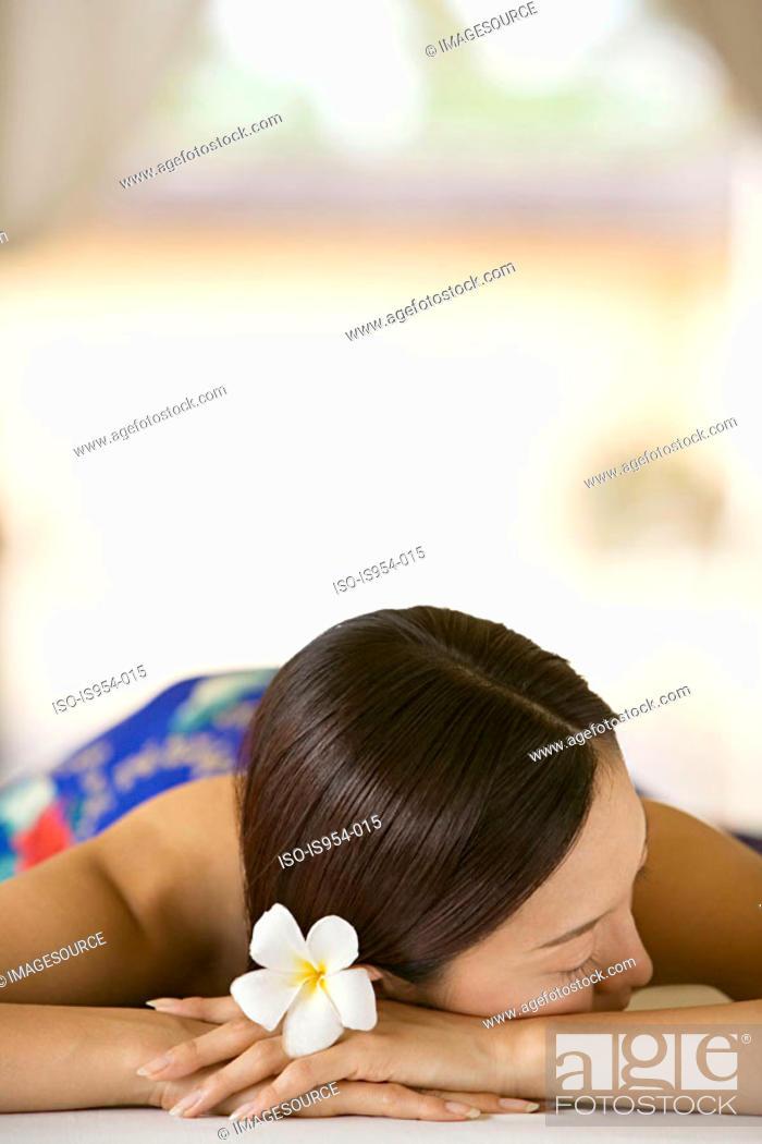 Stock Photo: Woman lying on massage table.