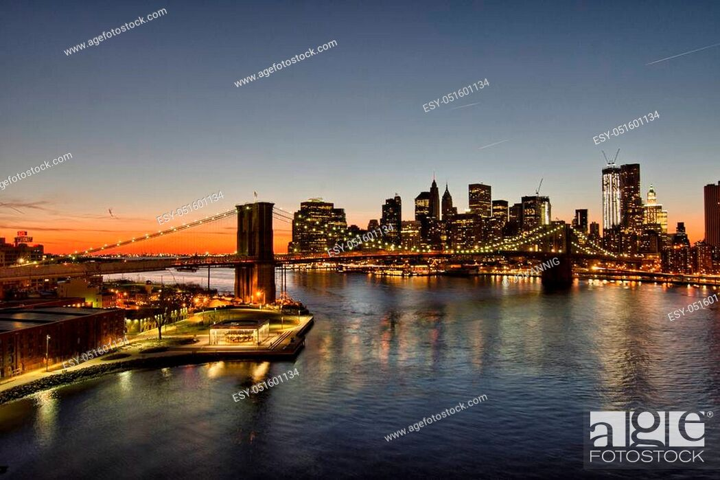 Stock Photo: Wonderful lights of Brooklyn Bridge at winter sunset, New York City.