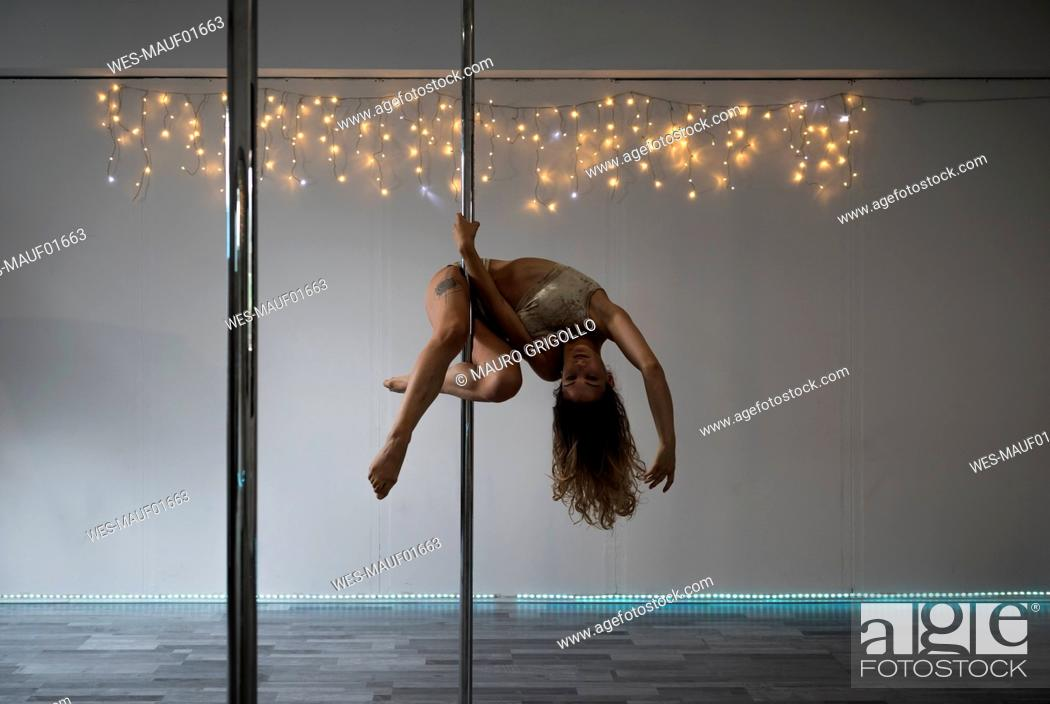 Stock Photo: Pole dancer during a performance.