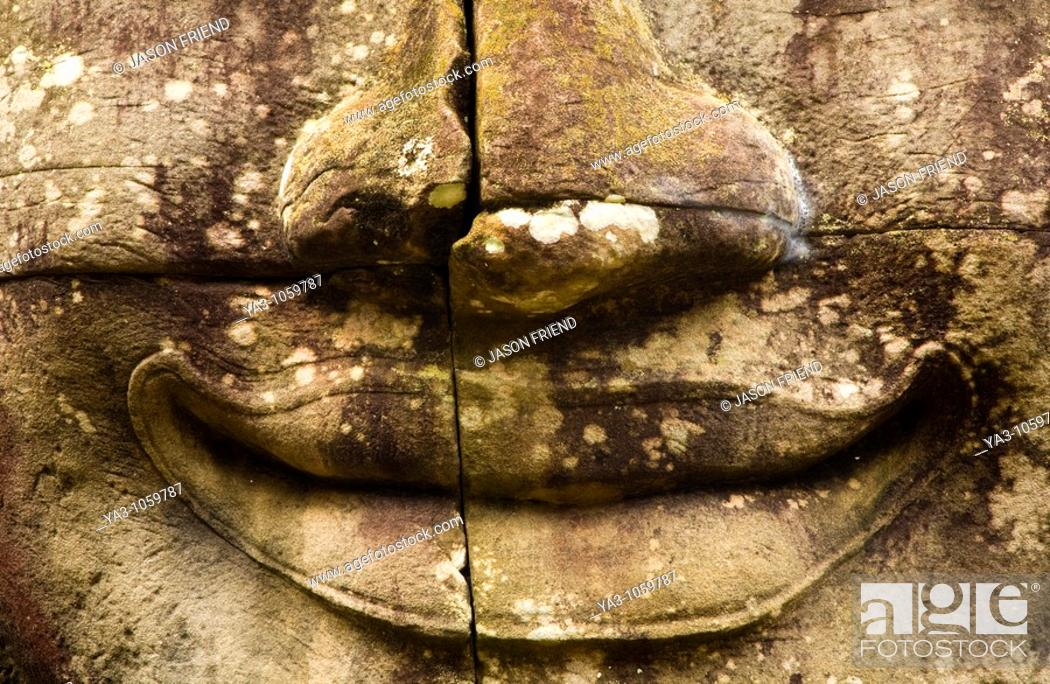 Stock Photo: Cambodia, Angkor Thom, Bayon  Massive stone faces watch your every move at Bayon, a well-known and richly decorated Khmer temple at Angkor in Cambodia.
