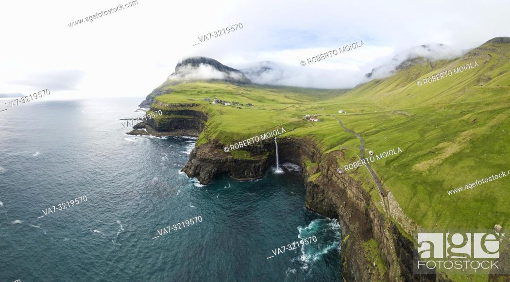 Stock Photo: Aerial panoramic of waterfall and cliffs, Gasadalur, Vagar island, Faroe Islands, Denmark.