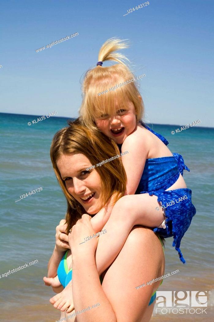 Stock Photo: Mother and Child on Beach, Sandbanks Provincial Park, Ontario, Canada.