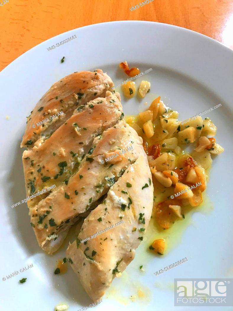 Stock Photo: Chicken breast with garlic and olive oil.