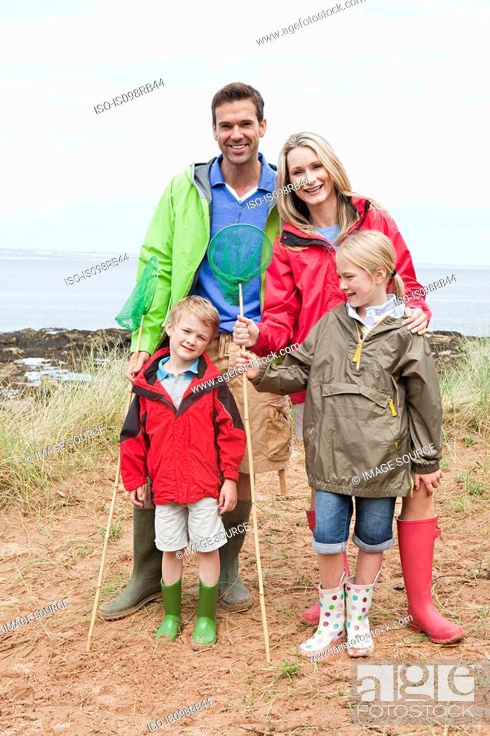 Stock Photo: Family at coast with fishing nets.