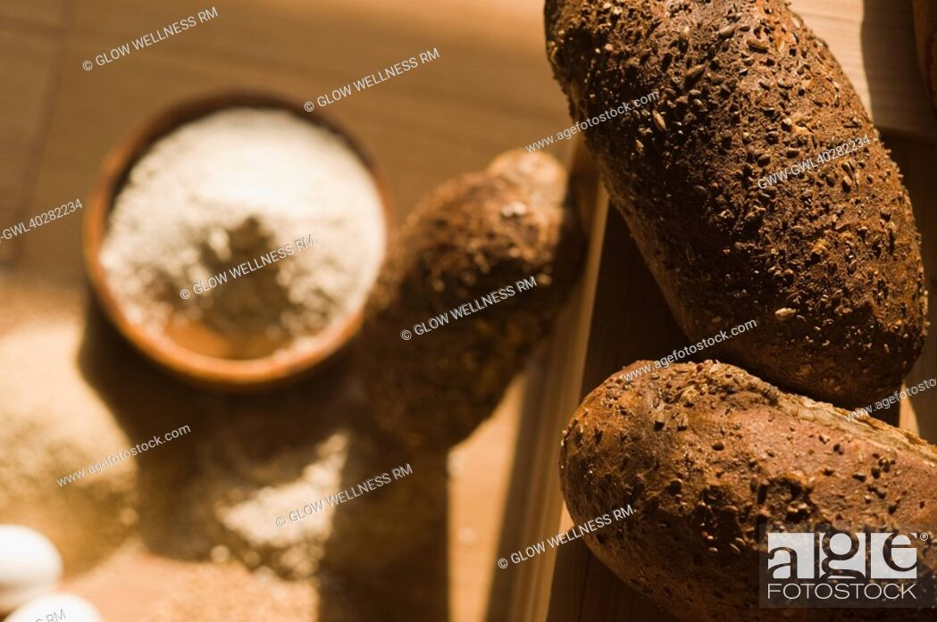 Imagen: Close-up of breads with a bowl of flour.