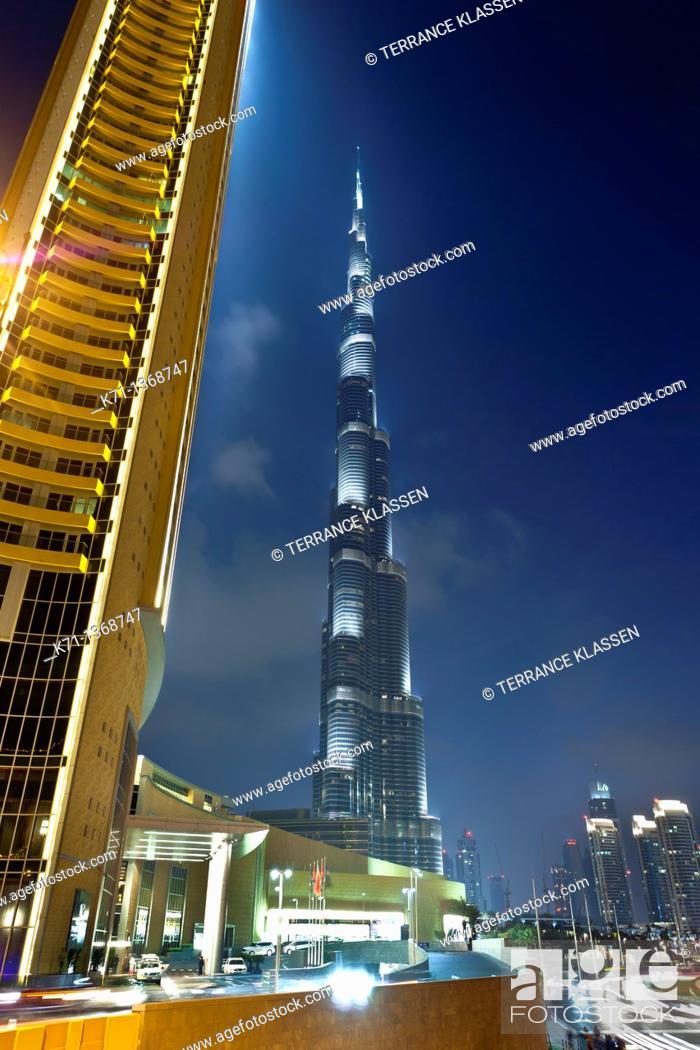 Stock Photo: The Burj Al Khalifa tower illuminated at night near the Dubai Mall in Dubai, UAE.