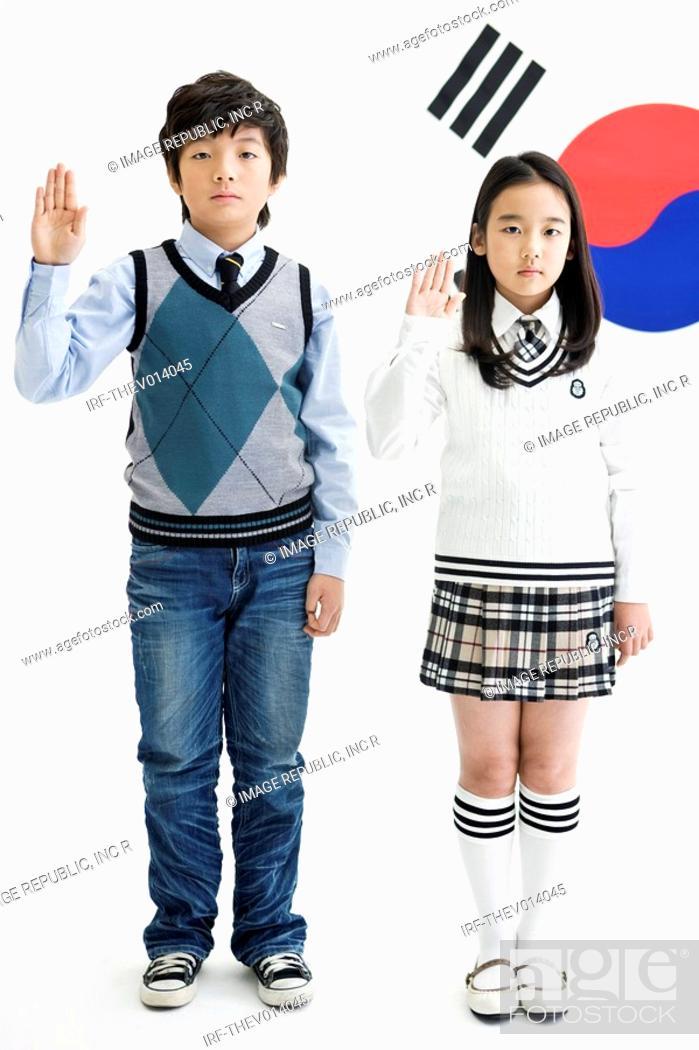 Stock Photo: boy and girl in front of Korean flag, Taegeukgi.