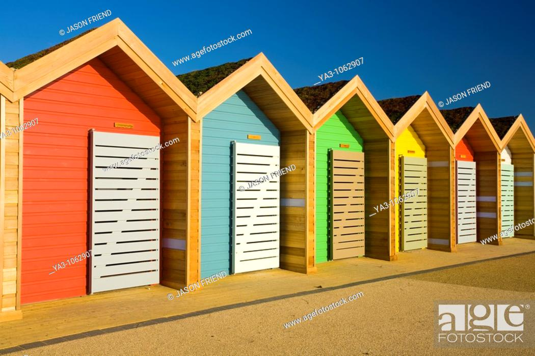 Stock Photo: England, Northumberland, Blyth  New colourful beach huts on the promenade at Blyth Beach.