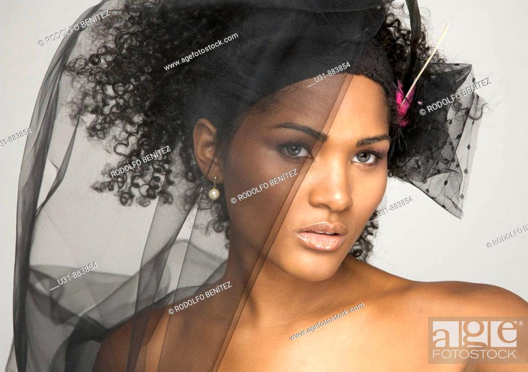 Stock Photo: Black Latin girl with sexy wavy hair and black veil.