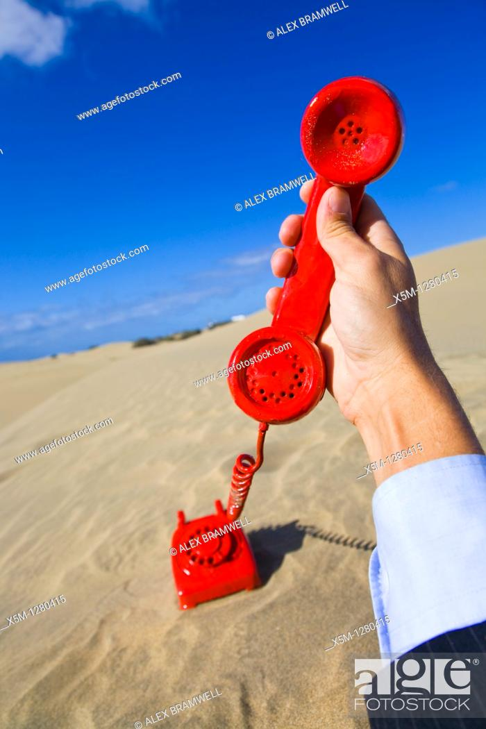 Stock Photo: The Red Phone Must Be Answered.