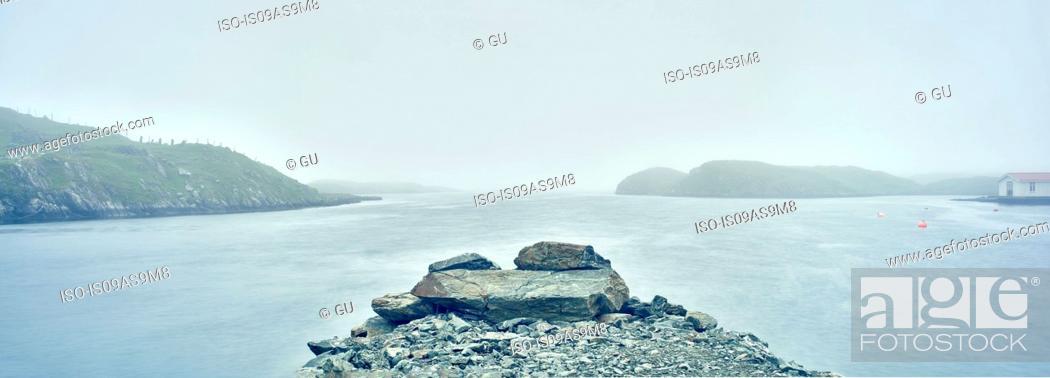 Stock Photo: Misty view across water of rocky islands, Haugesund, Rogaland County, Norway.