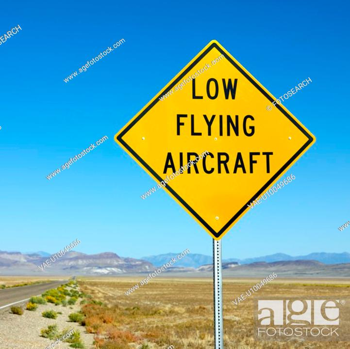 Stock Photo: Low flying aircraft sign alongside desloate highway.