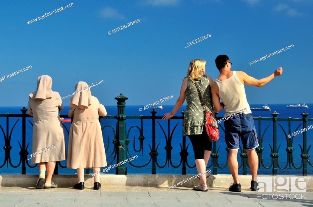 Stock Photo: Two nuns and a couple of touristes. Tarragona.