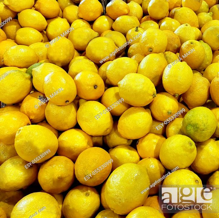 Stock Photo: Yellow lemons. A large quantity of lemons in a pile.