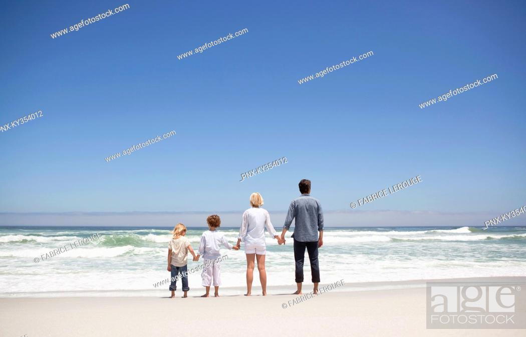 Stock Photo: Family looking at sea view from beach.