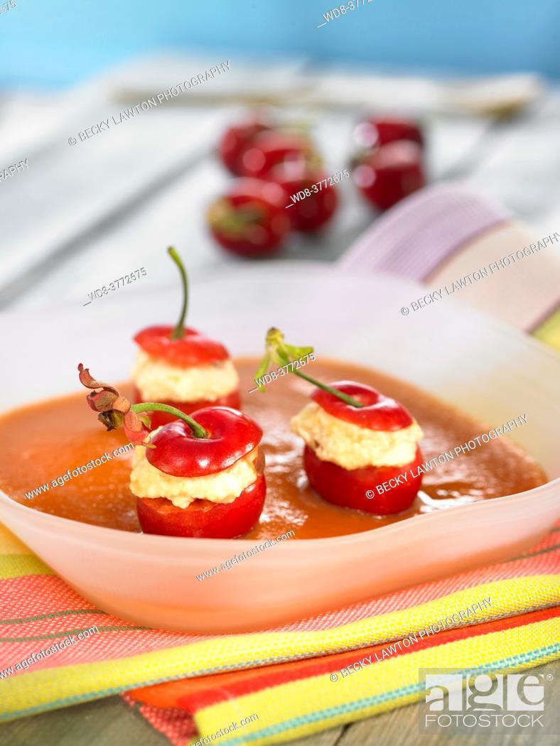Stock Photo: loquat agar with stuffed cherries.