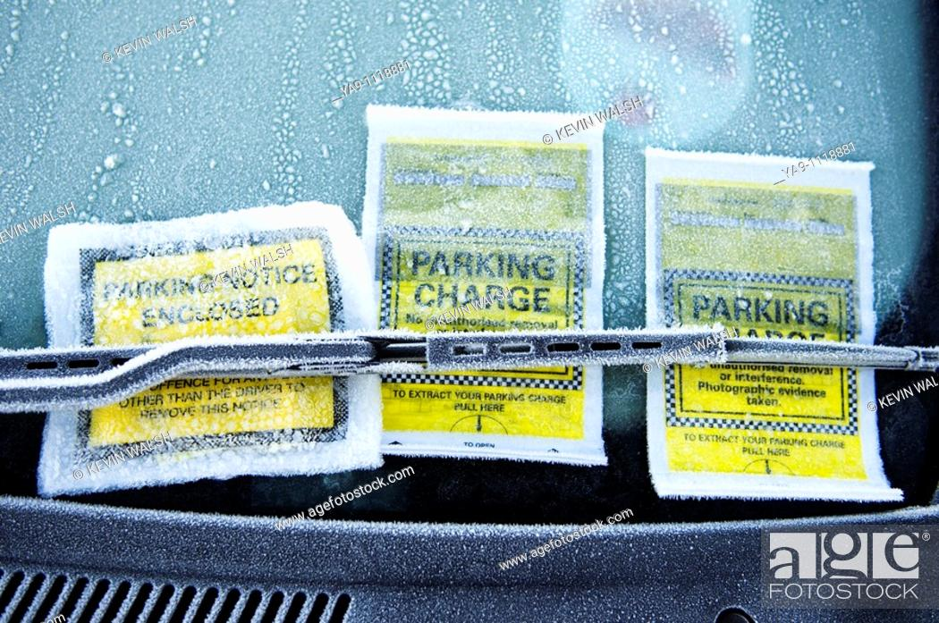 Stock Photo: Parking tickets stuck to car window.