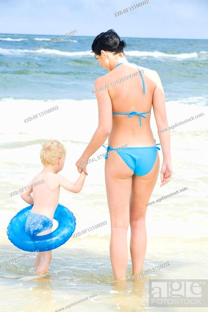 Stock Photo: mother with son going into sea.