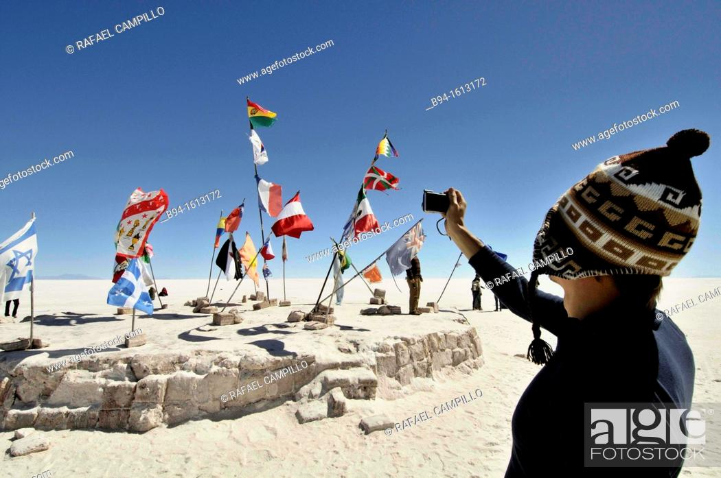 Stock Photo: Flags. Salar de Uyuni (or Salar de Tunupa),the world's largest salt flat at 10,582 square kilometers. It is located in the Potosí and Oruro departments in.