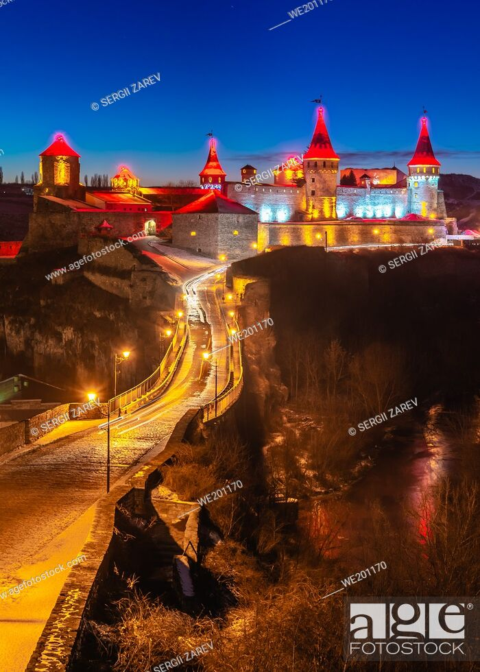 Stock Photo: Kamianets-Podilskyi, Ukraine 01. 07. 2020. Panoramic view of the Kamianets-Podilskyi fortress on a winter night.