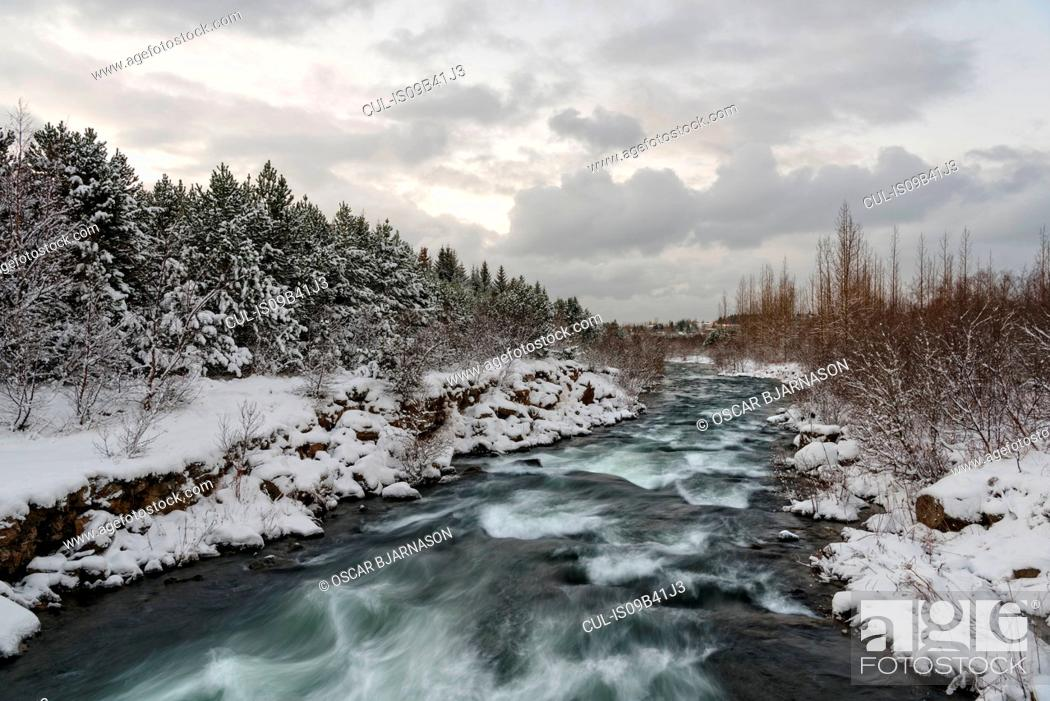 Stock Photo: River with strong current, Ellidaardalur, Iceland.