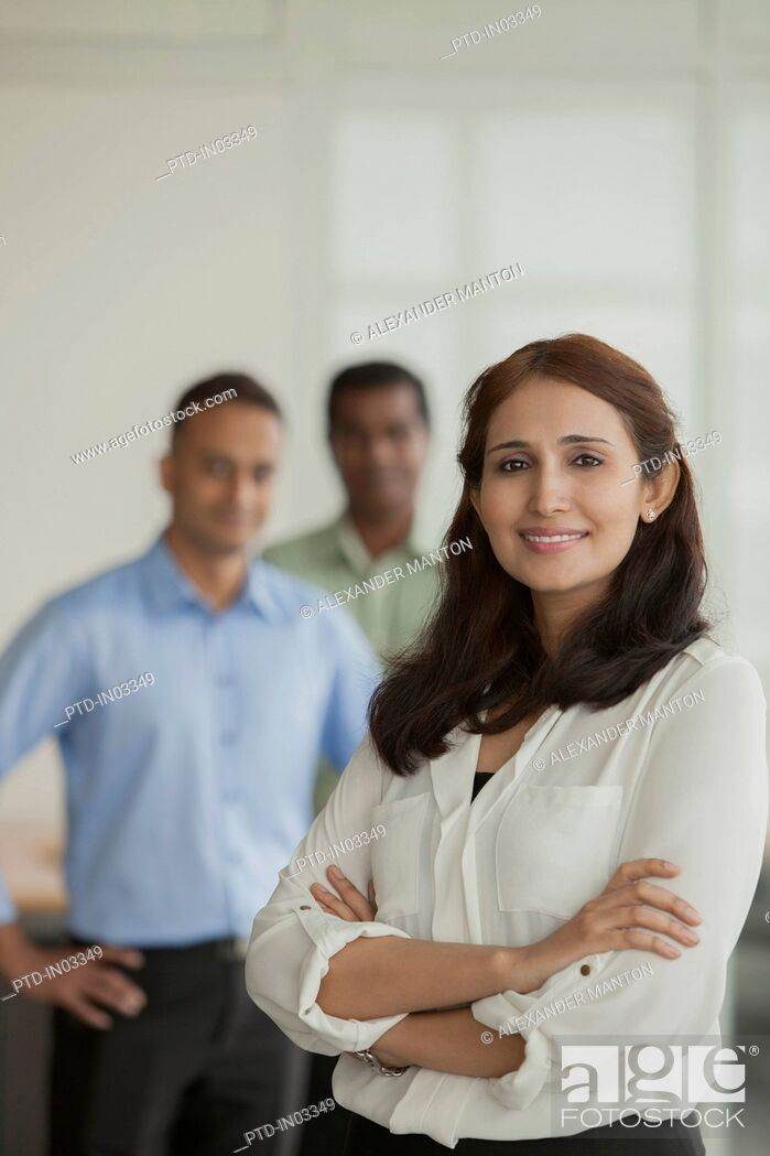 Stock Photo: Singapore, Business people standing in office.