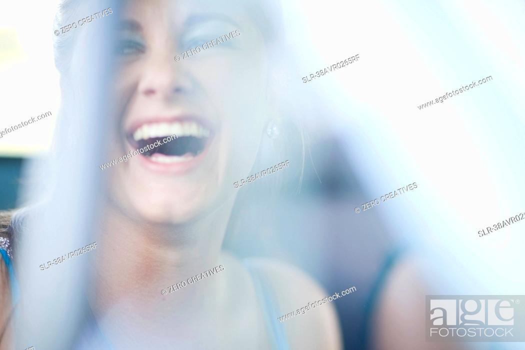 Stock Photo: Teenage girl laughing.