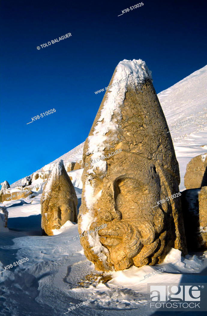 Stock Photo: Colossal heads of Herakles and Apollo, remains of the tomb-sanctuary of King Antiochus Theos in the West terrace of Nemrut Dag (Mount Nemrut.