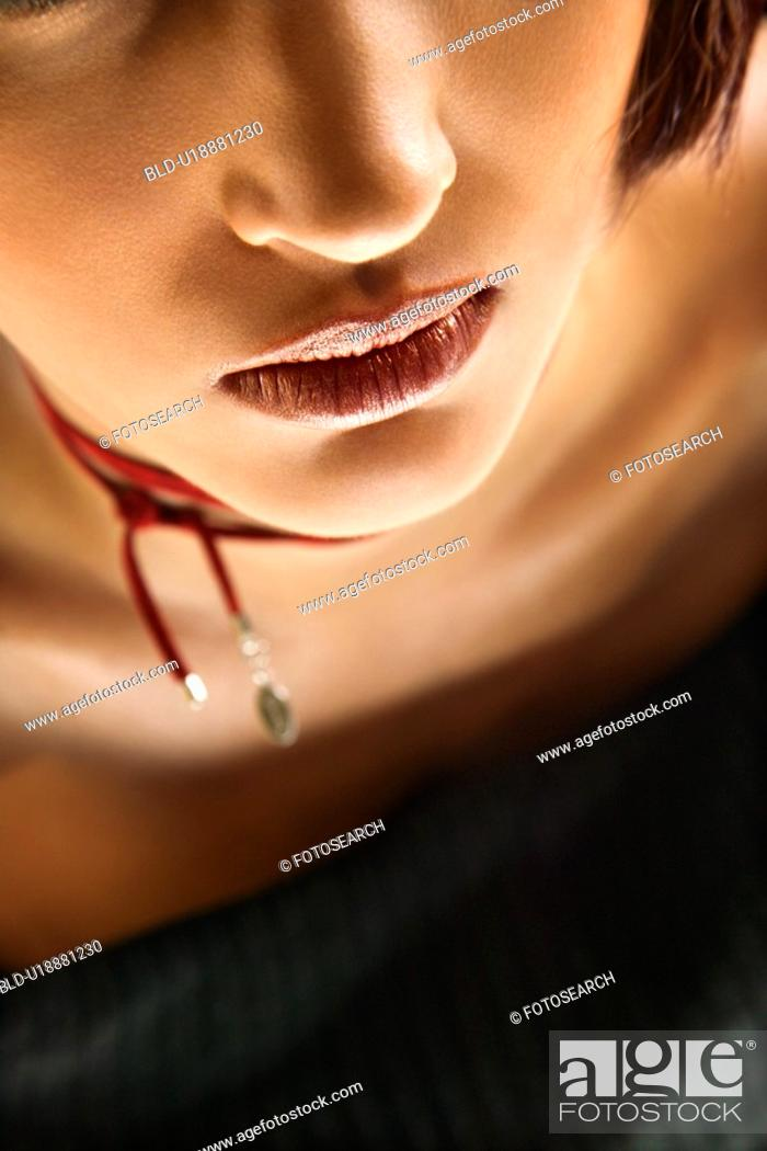 Stock Photo: Close up portrait of young Caucasian woman.