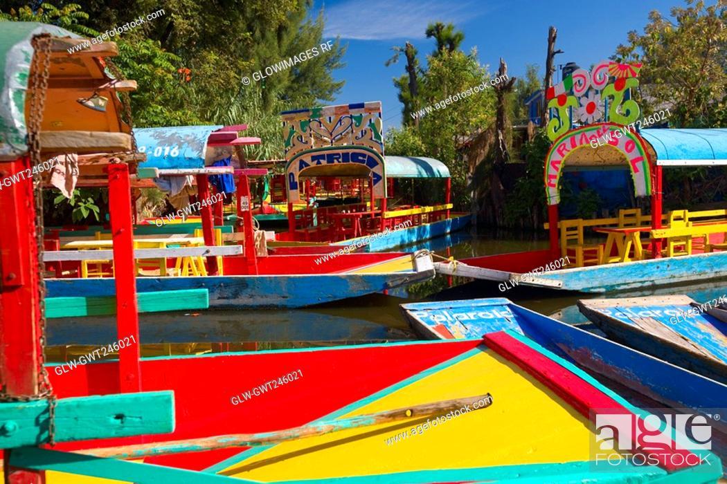 Stock Photo: Trajineras boats in a canal, Xochimilco Gardens, Mexico City, Mexico.