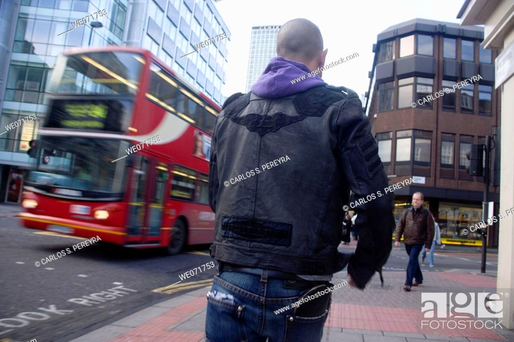 Stock Photo: Young man walking in London, England.
