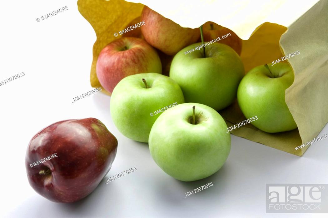 Stock Photo: Apples out of a shopping bag.