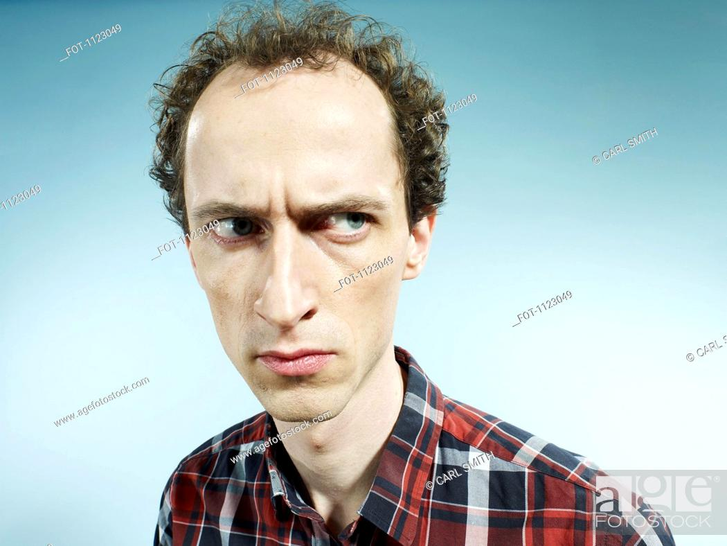 Stock Photo: A man looking suspiciously to the side.