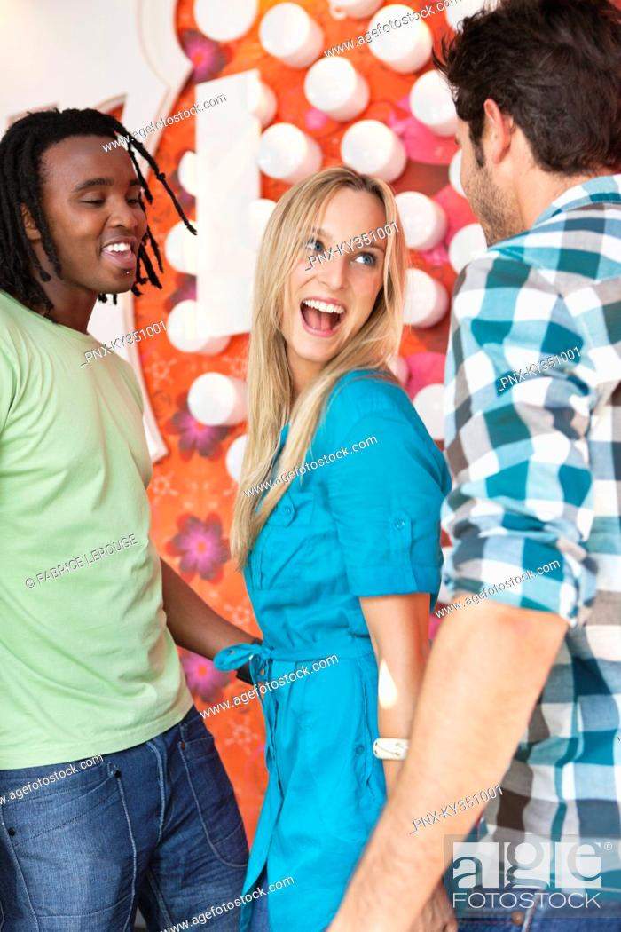 Stock Photo: Friends enjoying in a bar.
